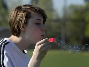 Grade 9 student Cassia Oddo blows bubbles during Mindful Monday on May 16 at Sheldon-Williams Collegiate in Regina.