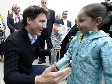 Prime Minister Justin Trudeau meets 7 year old Keslee Bear from Muskowpeetin first nation as he arrives at the Treaty Four Governance Centre in Fort Qu'Appelle Saskatchewan Tuesday April 26, 2016 before meeting with the leaders of the File Hills Tribal Council.