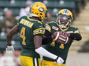The Saskatchewan Roughriders reportedly are interested in acquiring quarterback James Franklin (14), shown here in action with the Edmonton Eskimos last season.