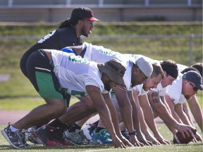 Backup quarterback Phil Sims practises working under centre with the Riders' offensive line during Friday's walkthrough.