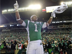 The Saskatchewan Roughriders' Kory Sheets celebrates after the team's 2013 Grey Cup victory on Taylor Field.