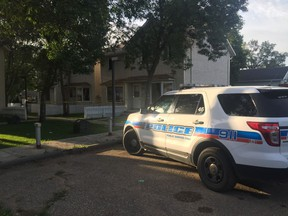 A single police cruiser sat in the alley near a taped-off duplex on the 700 block of Retallack Street on Thursday morning.