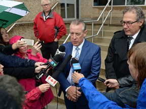 Former deputy premier Don McMorris talks to reporters outside court after pleading guilty to impaired driving and receiving a fine of $1,820 and a one-year licence suspension.
