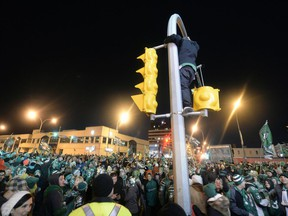Photos of fans that poured onto the Green Mile on Albert St. to celebrate the Riders victory in Grey Cup 101 in Regina Monday November 25 2013.