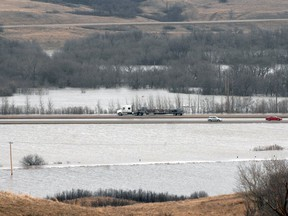 Water from the Qu'Appelle River encroaches on Highway 11 near Lumsden in 2011.