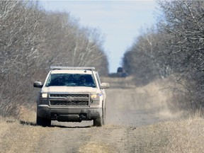 An RCMP truck from Southey drives on a grid road approximately 25 kilometres north of Craven.