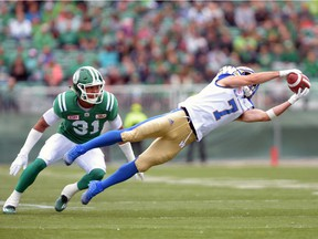 The Winnipeg Blue Bombers' Weston Dressler, right, makes the most spectacular of his seven catches during the 2016 Labour Day Classic against his former team, the Saskatchewan Roughriders.