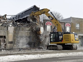 A track hoe from Davies Excavating LTD. was being used to knock down the top floor of the Travellers Building on the 1800 block of Broad street in Regina.