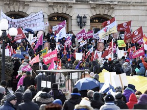 Hundreds attend a noon hour rally at the Legislative Building in March protesting cuts by the Saskatchewan Party government.