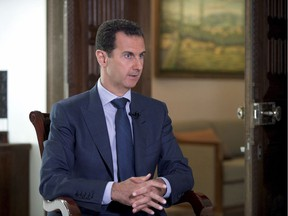 In this Wednesday, Sept. 21, 2016 photo released by the Syrian Presidency, Syrian President Bashar Assad speaks to The Associated Press at the presidential palace in Damascus, Syria. Syria decried a U.S. missile strike early Friday, April 7, 2017 on a government-controlled air base where U.S. officials say the Syrian military launched a deadly chemical attack.