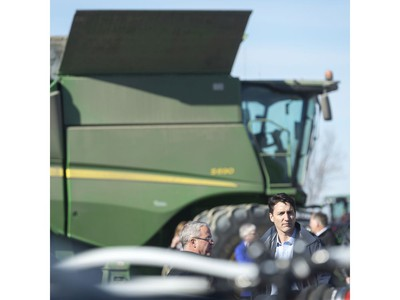 GRAY, SASK : April 27, 2017 - Rod Lewis, center, shows Prime Minister Justin Trudeau, right, around the Lewis Family Farm. MICHAEL BELL / Regina Leader-Post.