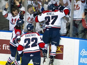 Lethbridge Hurricanes defenceman Brennan Menell celebrates the first goal of the night along with teammates Tyler Wong and Egor Babenko on Tuesday. Lethbridge went on to beat the Regina Pats 3-1 in Game 3 of the WHL's Eastern Conference final at the Enmax Centre.