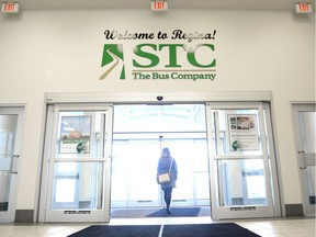 A woman walks out of the Saskatchewan Transportation Company bus terminal.