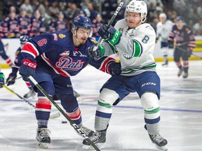 The Regina Pats' Chase Harrison battles with the Seattle Thunderbirds' Scott Eansor during Game 4 of the WHL championship series on Wednesday in Kent, Wash.