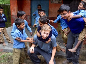 Jonah Toth, seen here giving piggy back rides to children during a volunteer trip to India, will receive the Regina Young Humanitarian of the Year Award at the 9th annual Power of Humanity Gala in Regina, Thursday, Oct. 26, 2017.