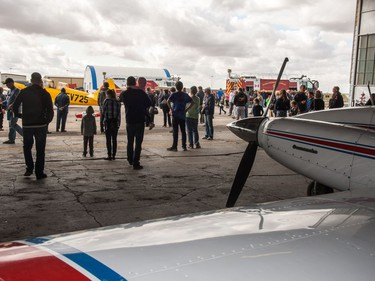 Visitors gather inside and outside the hanger to view unique aircraft during the Regina Flying Club's open house event in Regina, Saskatchewan on September 17, 2017.