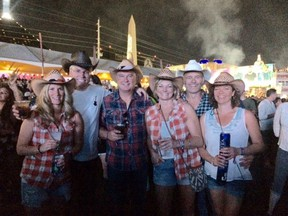 Todd, second from right, and Elan Lawrence, right, attended the Route 91 Harvest Music Festival in Las Vegas Sunday. The Weyburn couple, pictured here with friends Kerri Robins, Jerry LaFoy, Darren Larson and Teresa LaFoy, escaped from the shooting without injuries.