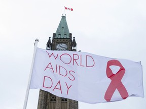 The World AIDS Day flag flies on Parliament Hill in Ottawa on Thursday, Dec. 1, 2016.