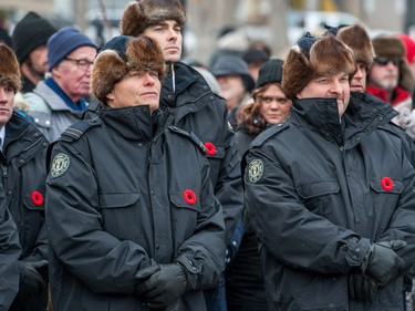 Members of the Regina fire department stand at the front of the crowd during the Remembrance Day service in Victoria Park.