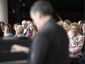 Pianist David McIntyre (foreground) plays a piece written for Jacqui Shumiatcher (right) prior to her receiving the Order of Canada, one of the country's highest civilian honours, at the Conexus Arts Centre on Thursday.