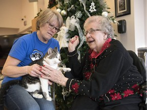 Louise Inglis, left, a volunteer with the Regina Humane Society, brings 3-year-old Sauron, on a pet therapy visit to Eleanor Biholar at the William Booth Special Care Home in Regina.