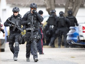 Members of the Regina Police Service and members of their SWAT team surrounded a home on the 1100 block of Elphinstone Street in Regina.