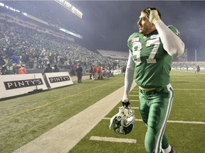 Former Saskatchewan Roughriders defensive end John Chick, who announced his retirement from football on Friday, walks off the field after a 2013 playoff victory over the B.C. Lions.