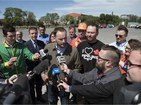 NDP Leader Ryan Meili held an outdoor press conference to propose a way to help create jobs in the steel industry and improve pipeline safety in Saskatchewan.  The event was held in the parking lot of the Turvey Centre.