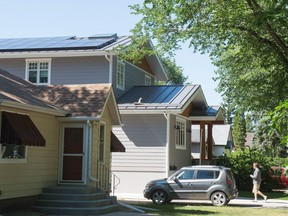 Matthew Pointer walks up the driveway to his home on Cameron Street. Pointer is a committee member with the Wascana Solar Co-operative and his house has solar panels affixed to its roof.