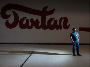 Michael Lavis, a member of the board of directors for the Tartan Curling Club, stands on the ice surface at the Tartan Curling Club on Broadway Avenue.