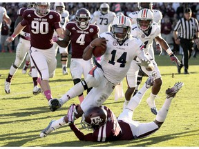 Nick Marshall of the Auburn Tigers rushes for a touchdown against the Texas A&M Aggies on Oct. 19, 2013. Marshall, now of the Saskatchewan Roughriders, ran for two touchdowns and threw for two more scores to lead Auburn to a 45-41 victory.