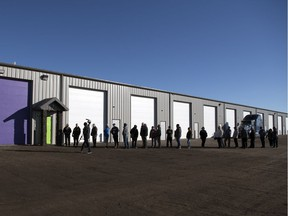 A lineup of customers wait for Eden, a legal shop set up to sell weed, to open just west of Pilot Butte on Wednesday, Oct. 17, 2018.