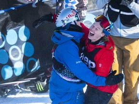 Regina's Mark McMorris, left, celebrates with Rene Rinnekangas of Finland after scoring 96 points on his final run to beat Rinnekangas' 94 and win the gold in the men's snowboard slopestyle final Saturday at the Winter X Games in Aspen, Colo.