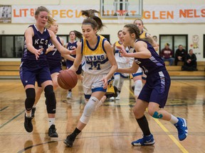 The O'Neill Titans'  Lexis Herman, 14, drives to the basket against the Kelowna Christian School Knights during senior girls action at the Luther Invitational Tournament on Thursday. O'Neill won 56-53.
