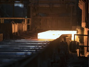 Evraz steel workers are facing layoffs due to a downturn in projects across the country.