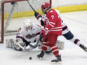 Regina Pat Canadians goalie Jared Thompson dives for the loose puck against the Notre Dame Hounds in Saskatchewan Midget AAA Hockey League playoff action Tuesday at the Co-operators Centre. Thompson got the shutout as Regina won 2-0.
