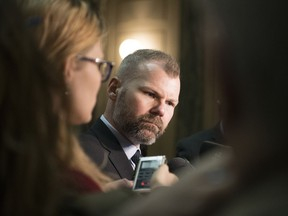 Dustin Duncan, minister of environment and minister responsible for SaskPower, speaks with reporters in the Legislative Building on March 4, 2019.