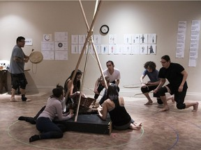 Members of the Making Treaty 4 Collective, including Teddy Bison (back left), Ben Ironstand (back centre) and Pete Kytwayhat (right), perform a scene from Making Treaty 4, which starts April 10 at Globe Theatre.