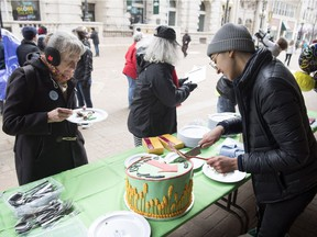 """Saima Desai, right, organizer of the Fight for $15 Saskatchewan is holding """"DEAD LAST,"""" a street party/protest to 'celebrate' the fact that Saskatchewan has the worst minimum wage in the country. The event was held over the noon hour on Scarth Street and 11th Avenue."""