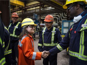 Canadian Foreign Affairs Minister Chrystia Freeland shakes hands with employees at the Evraz steel plant in Regina on May 22, 2019.