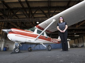 Audrey Kahovec, general manager of the Regina Flying Club, stands by a Cessna 150 inside the hanger at the Regina International Airport in Regina.