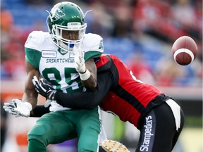 Saskatchewan Roughriders receiver Kyran Moore, 85, couldn't hold on to this pass from Cody Fajardo during Friday's 37-1 pre-season loss to the host Calgary Stampeders.