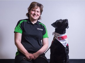 Kathy Calvin, therapy dog evaluator, and her dog Magic at the St. John Ambulance office on 3rd Avenue. Calvin and Magic are among numerous therapy dog teams working across the province, helping those experiencing physical or mental health issues or other concerns, attending hospitals, rehabilitation centres, schools and seniors homes.
