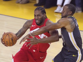 Toronto Raptors forward Kawhi Leonard (2) drives to the basket while Golden State Warriors forward Andre Iguodala (9) defends during Game 4 of the NBA Finals at Oracle Arena. (Sergio Estrada-USA TODAY Sports)