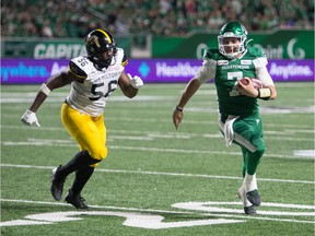 Cody Fajardo, right, rushed for a game-high 56 yards while quarterbacking the Saskatchewan Roughriders to a 24-19 victory over the visiting Hamilton Tiger-Cats on Thursday.