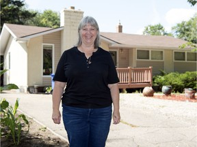 Lana Mueller, daughter of Saskatchewan Roughriders icon Ron Lancaster, stands outside her family's former home on Emerald Park Road in Regina.