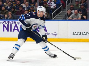 Adam Lowry, formerly of the Swift Current Broncos, is to play for the Winnipeg Jets against the Calgary Flames in Saturday's NHL Heritage Classic at Mosaic Stadium.