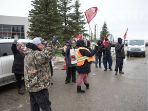 Unifor members continue their strike action at a SaskTel building located near the airport in Regina.