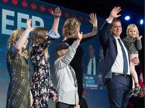 Leader of the Conservative Party of Canada Andrew Scheer and family wave at the crowd at the Conservative headquarters at the International Trade Centre at Evraz Place.