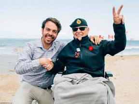 Juno Beach, Normandy -- Documentary filmmaker Eric Brunt, who spent almost a year criss-crossing the country to speak with 400 Canadian veterans of the Second World War, joins Frank Krepps at Juno Beach on the anniversary of D-Day this June, almost a year after the filmmaker had interviewed the veteran at Krepp's Red Deer, Alta., home. (Submitted photo)